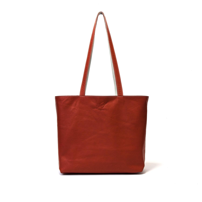 leren handgemaakte omkeerbare tas wit en oranje